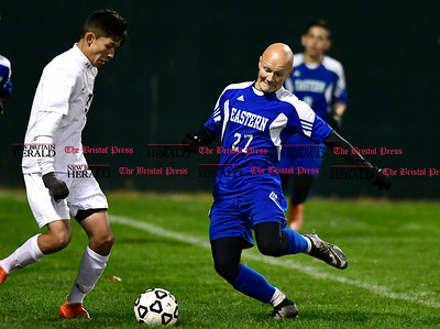 11/1/2016 Mike Orazzi | Staff Bristol Central's Dante Prado (3) and Bristol Eastern's Lyle Winiarski (27) during boys soccer at Muzzy Field Tuesday night.