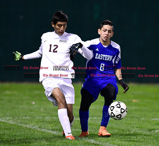 11/1/2016 Mike Orazzi | Staff Bristol Central's Jonathan Cabrera (12) and Bristol Eastern's Dante Constantiello (8) during boys soccer at Muzzy Field Tuesday night.