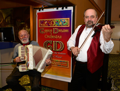11/12/2016 Mike Orazzi | Staff Gyspy Dreams' Gene Kozlowski and Andrew Mazur perform during the Immigrant Heritage Hall of Fame induction ceremony at Central Connecticut State University Saturday night.