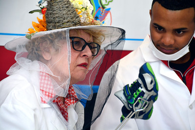 11/12/2016 Mike Orazzi | Staff Judges Joanne Platt and D'Andre Esposito sniff sneakers during the 15th Connecticut Odor-Eaters® Rotten Sneaker Contest held at The Imagine Nation, A Museum Early Learning Center  in Bristol Saturday.