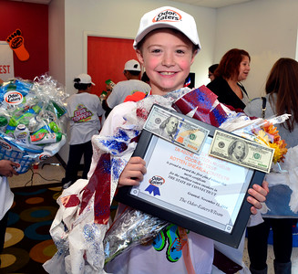 11/12/2016 Mike Orazzi | Staff Stone Lowe,7, after winning the 15th Connecticut Odor-Eaters® Rotten Sneaker Contest held at The Imagine Nation, A Museum Early Learning Center  in Bristol Saturday.