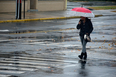 11/15/2016 Mike Orazzi | Staff Pedestrians make their way around downtown Bristol during some much needed rain Tuesday.