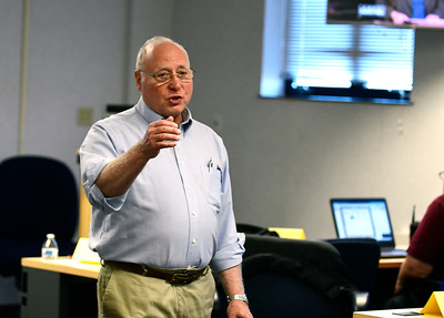 11/2/2016 Mike Orazzi | Staff Harley Graime, Emergency Management Director at City of Bristol, talks with local public safety agencies while preparing for a mock storm emergency in the training room at the Bristol Police Department Wednesday.