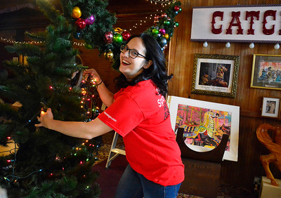 11/16/2016 Mike Orazzi | Staff ESPN volunteer Paula Grahame decorates the New England Carousel Museum in Bristol on Wednesday morning.