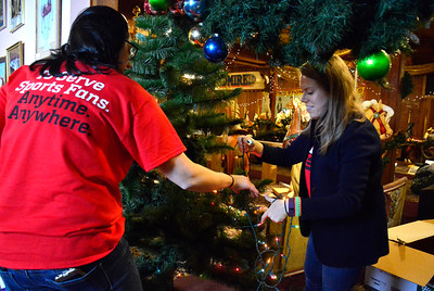 11/16/2016 Mike Orazzi | Staff ESPN volunteers Paula Grahame and Alexandra Carlson decorate the New England Carousel Museum in Bristol on Wednesday morning.