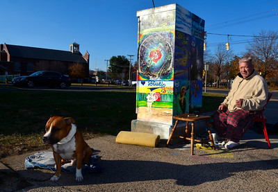11/17/2016 Mike Orazzi | Staff Gary Fortier and his dog Pudgy while he adds details to the traffic box on Church Street in Bristol Thursday.