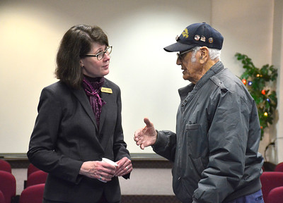 11/10/2015 Mike Orazzi | Staff Ed Riccio Jr. talks with Teresa Goulden during a free Veterans Coffee Social hosted by Bristol Press Columnist Bob Montgomery and sponsored by the Manross Library for the 7th year Tuesday morning.