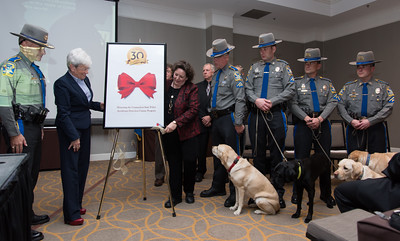 "111716  Wesley Bunnell | Staff  On Thursday the CT State Police commemorated the 30th anniversary of the country's and possibly the worlds first operational accelerant detection canine (ADC), ""Mattie"" who became field operational on Sept 1, 1986. . Currently four ADC's are assigned to the Fire & Explosion Investigation Unit. From the program's inception 93 accelerant detection canines have been trained by the CT State Police from other states and countries.  Unveiling a 30th anniversary commemorative  statue are, from left, Col. Alaric Fox, Lt. Governor Nancy Wyman, Founding Board of Trustree for Tails of Hope Linda Blilck MSW, Det. Joh Sawyer with ADC ""Sophie"", Det. Paul Macuk with ADC ""Cora"", Det. Wayne Opdenbrouw with ADC ""Sprite"" & Det. Joe Lombardi with ADC ""Clauss""."