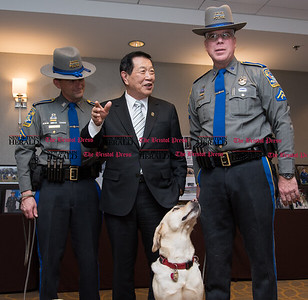 "111716  Wesley Bunnell | Staff  On Thursday the CT State Police commemorated the 30th anniversary of the country's and possibly the worlds first operational accelerant detection canine (ADC), ""Mattie"" who became field operational on Sept 1, 1986. . Currently four ADC's are assigned to the Fire & Explosion Investigation Unit. From the program's inception 93 accelerant detection canines have been trained by the CT State Police from other states and countries.  From left, Det. Wayne Opdenbrouw with ADC ""Sprite"", Dr. Henry Lee, Det. John Sawyer with ADC ""Sophie""."