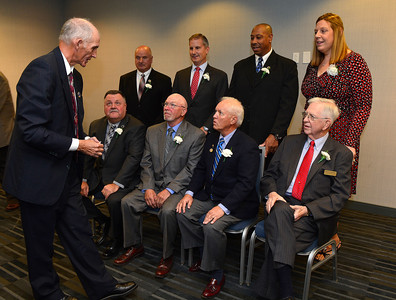 11/18/2016 Mike Orazzi | Staff Hank Lodge talks with inductees into the Bristol Sports Hall of Fame presents it's 20th Annual Dinner for the Class of 2016 at the DoubleTree by Hilton Hotel in Bristol Friday night.