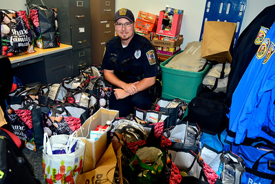 11/18/2016 Mike Orazzi | Staff Bristol Officer George Franek with Thanksgiving bags for area needy families provided by the Bristol Police Explorers.
