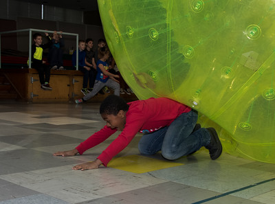 112116  Wesley Bunnell | Staff  Edgewood Elementary School held a hamster themed day which included a human hamster ball for the staff and students to enter. Students in Ms. Schulitz's fourth grade class took their turns inside the hamster ball including Nelson Riley, age 9, as he exits after his turn.