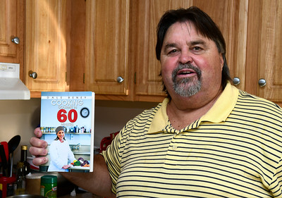 11/1/2016 Mike Orazzi | Staff Dale Reney while cooking in his Bristol apartment.