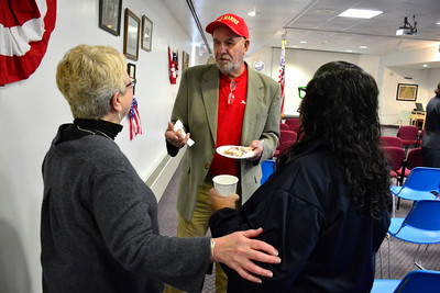 11/10/2015 Mike Orazzi | Staff Bob Montgomery talks with Maureen Eaton and Rita Garza during a free Veterans Coffee Social hosted by Bristol Press Columnist Bob Montgomery and sponsored by the Manross Library for the 7th year Tuesday morning.