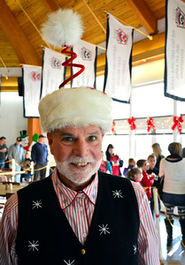 12/5/2015 Mike Orazzi | Staff Kevin Prior volunteers as an elf during the Annual Breakfast with Santa held at the Giamatti Little League Center Dining Hall on Saturday morning.