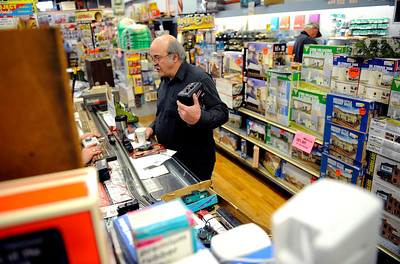 11/24/2012 Mike Orazzi | Staff Steve Amato walks through the aisles of Amato's Toy and Hobby in New Britain on Saturday.