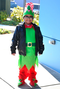 12/5/2015 Mike Orazzi | Staff  Isaiah Hernandez dressed as an elf while on his way to see Santa during the 4th Annual YWCA Holiday Extravaganza & Craft Show in downtown New Britain on Saturday.
