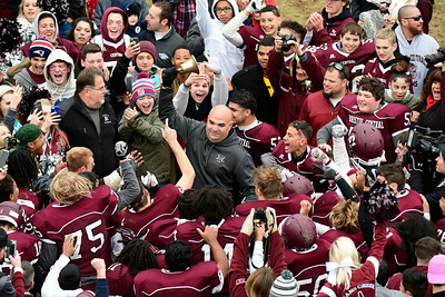 11/24/2016 Mike Orazzi | Staff Bristol Central Football Coach Jeff Papazian celebrates by ringing the b after a win over Bristol Eastern during the annual Battle for the Bell at Muzzy Field Thursday.