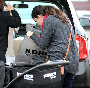 11/25/2016 Mike Orazzi | Staff Natalie Collins while loading items she bought while Black Friday shopping at the Kohl's in Plainville Friday.