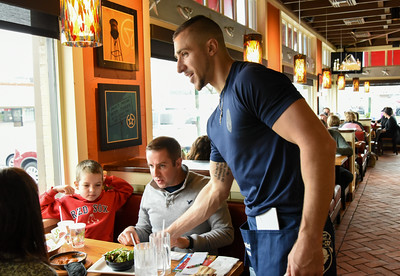 112416  Wesley Bunnell | Staff  Member of the New Britain Police Department volunteered to work shifts at Chili's on Friday afternoon with all tips received going towards Special Olympics. Ofc. Matthew Sulek who gained attention recently as the Dancing Cop tends to a table.