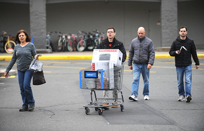 11/25/2016 Mike Orazzi | Staff Members of the Caruso family while Black Friday shopping at the Bristol Walmart where they began their shopping for the day. Left to right, Jean, Nick, Steve and Jim.