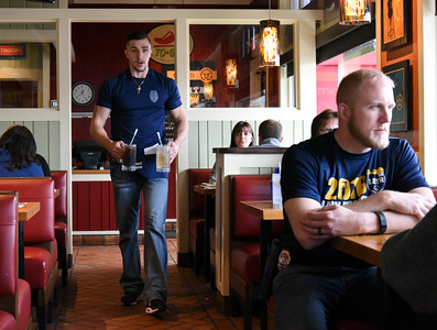 112416  Wesley Bunnell | Staff  Member of the New Britain Police Department volunteered to work shifts at Chili's on Friday afternoon with all tips received going towards Special Olympics. Ofc. Matthew Sulek who gained attention recently as the Dancing Cop brings drinks out to customers.
