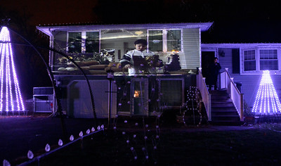 11/25/2016 Mike Orazzi | Staff Lights on Rosewood at 111 Rosewood Drive in Bristol Friday night in his honor.