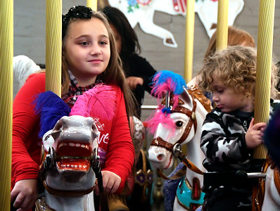 11/26/2016 Mike Orazzi | Staff Paulina and her brother Mario Locascio ride the carousel during the Kids' Carnival held at the New England Carousel Museum Saturday.