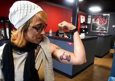 11/26/2016 Mike Orazzi | Staff Mayra Cruz shows off a tattoo she she had done at City Ink in New Britain in honor of her brother Mark Lopez who died in a traffic accident a few weeks ago on I-84 near exit 49.