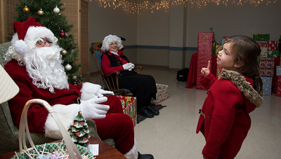 112816  Wesley Bunnell | Staff  Santa and Mrs. Clause were in Berlin Monday evening as part of Santa's Parlor held at the Community Center. Lilly Chandler, age 4, makes her case for toys with Santa.