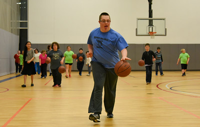 112816  Wesley Bunnell | Staff  The Bristol Boys and Girls Club held Ed Beardsley Discovery Challenger Basketball on Monday evening for children and young adults with special needs. Cameron Couch , age 16, dribbles the ball up court.