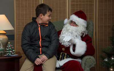 112816  Wesley Bunnell | Staff  Santa and Mrs. Clause were in Berlin Monday evening as part of Santa's Parlor held at the Community Center.  Gabe Chandler, age 10, tells Santa his wish list.
