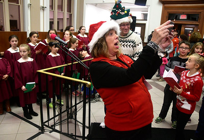 11/29/2016 Mike Orazzi | Staff Sheila Kelley during the 65th Annual Bristol Carol Sing and the 26th Annual Holiday Lighting Ceremony held inside Webster Bank on Main Street Tuesday night.