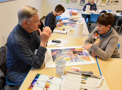112916  Wesley Bunnell | Staff  Tom Anderson, shown left,  with instructor June Webster in the adult watercolor class at the New Britain Museum of American Art on Tuesday afternoon.