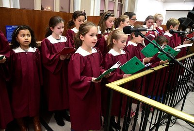 11/29/2016 Mike Orazzi | Staff The St. Joseph Church Children & Youth Choir during the 65th Annual Bristol Carol Sing and the 26th Annual Holiday Lighting Ceremony held inside Webster Bank on Main Street Tuesday night.