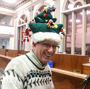 11/29/2016 Mike Orazzi | Staff Jim Hogan during the 65th Annual Bristol Carol Sing and the 26th Annual Holiday Lighting Ceremony held inside Webster Bank on Main Street Tuesday night.