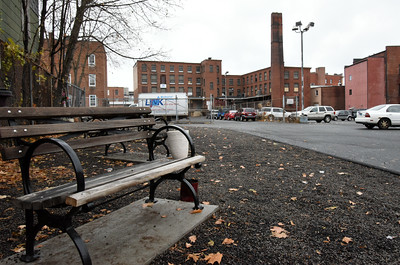 113016  Wesley Bunnell | Staff  Park benches behind the Friendship Service Center on Arch St on Wednesday afternoon. The parking lot has been the scene of a shooting and stabbing in the last several months.