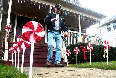 11/30/2016 Mike Orazzi | Staff Bob Dudley while decorating his home on Sherman Street in Bristol Wednesday.