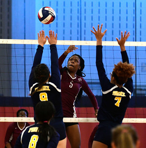 11/3/2016 Mike Orazzi | Staff Innovation's Kimberly Okeke (5) and HMTCA's Jada Ortiz (9) and Bashara Samuda (7) during the CRAL Volleyball Championship Thursday in New Britain.