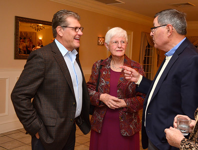 11/3/2016 Mike Orazzi | Staff UConn Women's Basketball Coach Geno Auriemma talks with Betty Fumiatti and Frank Miller during  the Boys & Girls Club of New Britain's 125th annual meeting and gala at the Farmington Club Thursday night.