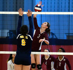 11/3/2016 Mike Orazzi | Staff Innovation's Bailee Nardi (3) and HMTCA's  Jada Ortiz (9) during the CRAL Volleyball Championship Thursday in New Britain.