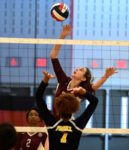 11/3/2016 Mike Orazzi | Staff Innovation's Bailee Nardi (3) and HMTCA's Bashara Samuda (7) during the CRAL Volleyball Championship Thursday in New Britain.