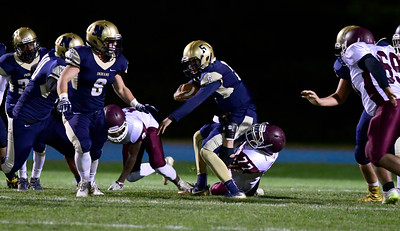 11/4/2016 Mike Orazzi | Staff Newington's Robert Sanchez (5) and Bristol Central's Tommy Nelligan (77) Friday night in Newington.