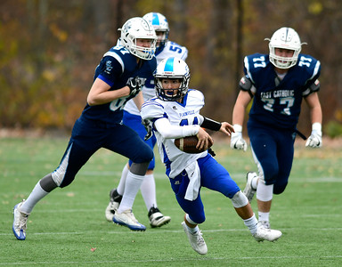 11/5/2016 Mike Orazzi | Staff Plainville's Frank Griffin (11) against East Catholic  Saturday at Cheney Vocational Technical School.