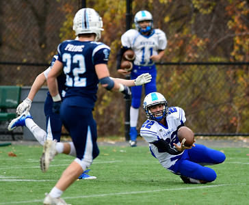 11/5/2016 Mike Orazzi | Staff Plainville's Brady Callahan (22) hauls in a pass against East Catholic  Saturday at Cheney Vocational Technical School.