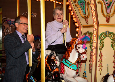 11/5/2016 Mike Orazzi | Staff John Murrone and his mother Patricia ride the carousel during the 2016 ACE awards held at The New England Carousel Museum and the Bristol Center for Arts & Culture Saturday night.