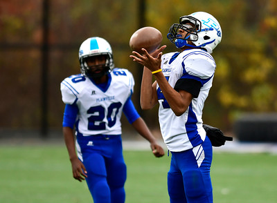 11/5/2016 Mike Orazzi | Staff Plainville's Jailen Lindsey (4) on a kick off Saturday at Cheney Vocational Technical School.