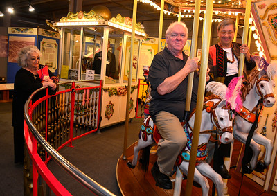 11/5/2016 Mike Orazzi | Staff Executive Director at New England Carousel Museum Louise DeMars looks on as Ken Ferris and his wife Marylou ride the carousel during the 2016 ACE awards held at The New England Carousel Museum and the Bristol Center for Arts & Culture Saturday night.