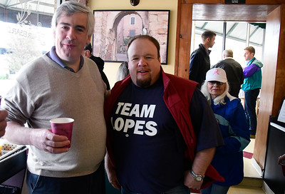 11/5/2016 Mike Orazzi | Staff Tim O'Brien talks with state rep Rick Lopes during  a Getting Out The Vote Breakfast at Cafe Beauregard in downtown New Britain Saturday morning.