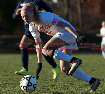 100716  Wesley Bunnell | Staff  Terryville captain Jenna Covello (2) stumbles after being tripped up during a Class S first round girls soccer tournament game against HMTCA on Monday afternoon at Terryville High.